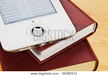 Paper Books And Electronic Reader