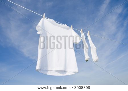 White T-Shirt And Socks On Blue Sky