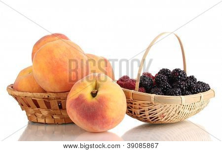 Ripe raspberries, brambles and peaches isolated on white