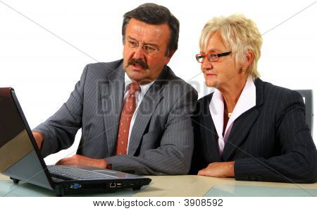 Mature Business Team With Laptop