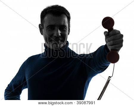 one causasian man on the phone portrait in silhouette studio isolated on white background