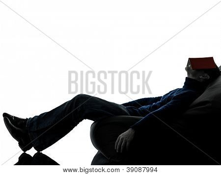one causasian man reading book full length in silhouette studio isolated on white background
