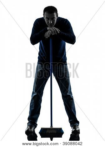 one causasian man janitor brooming cleaner boredom full length in silhouette studio isolated on white background