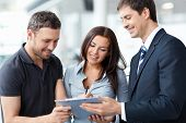 stock photo of rental agreement  - Seller and buyer in the showroom - JPG