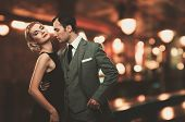 picture of mafia  - Retro couple over blurred background - JPG