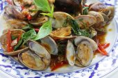 stock photo of thai cuisine  - stir fried clams with roasted chili paste and thai sweet basil - JPG