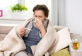 stock photo of throat  - Sick Woman with Thermometer - JPG