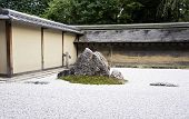 Famous Zen Garden Of The Ryoan-ji Temple