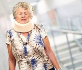 stock photo of neck brace  - A Senior Woman Wearing A Neck brace - JPG