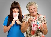 Mother And Daughter With Pop Corn, Ticket And 3d Glass On Gray Background