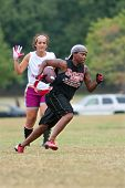 Female Flag Football Player Sprints For End Zone