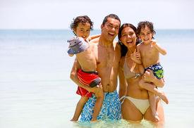 stock photo of family vacations  - happy family having fun on vacation  - JPG