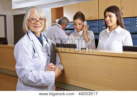 Doctor and receptionist at reception in a hospital