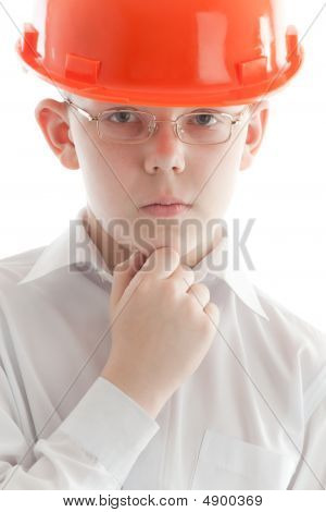 Pensive Teenager In Glasses And Protective Helmet