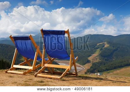 Two Deckchairs In Mountain
