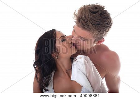 Young romantic couple kissing, isolated on white