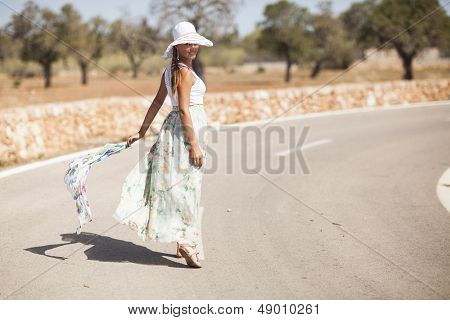 young woman is on a road