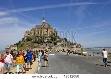 MONT SAINT MICHEL, BRITTANY, FRANCE - AUGUST 11: People visiting the mont saint michel, in the north of france, August 11, 2012 in Mont Saint Michel, Brittany, France