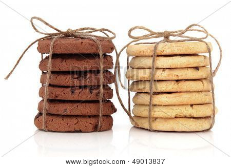 Chocolate chip cookie stacks tied with string over white background.