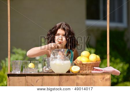 little girl making lemonade