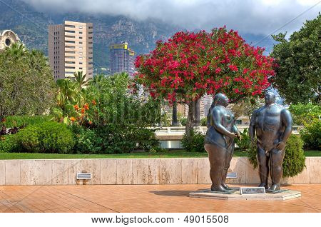 MONTE CARLO, MONACO - JULY 13: Adam and Eve composition - sculpted by Fernando Botero in 1981, situated in park near Casino and is one of the famous sculptures in Monte Carlo, Monaco in July 13, 2013.