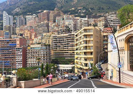 MONTE CARLO, MONACO - JULY 13: Street and residential buildings of Monte Carlo -  one of the four quarters founded in 1866, highly popular with tourists in principality of Monaco on July 13, 2013.