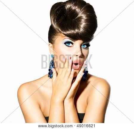 Fashion Surprised Model Girl Portrait with Blue Eyes and Earrings. Creative Hairstyle. Hairdo. Make up. Beauty Woman isolated on a White Background. Open Mouth, Emotions