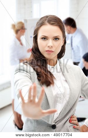 business concept - angry businesswoman showing stop gesture