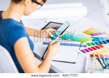 interior design and renovation concept - woman working with color samples for selection