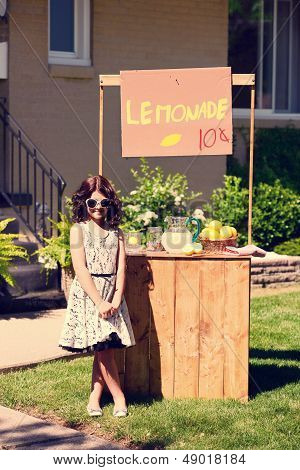 vintage little girl and her lemonade stand