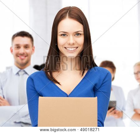business and delivery service concept - smiling woman holding cardboard box
