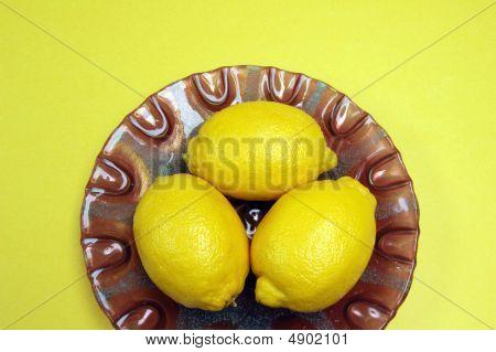Lemons On Purple Plate
