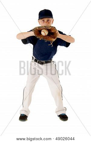 Young baseball player with ball in baseball glove