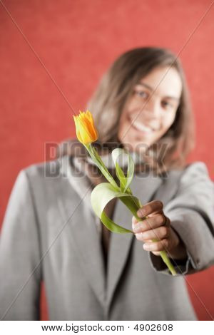 Handsome Young Man With Yellow Tulip