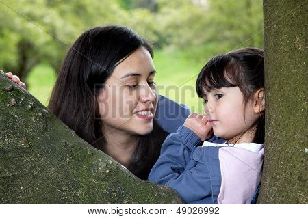 Mother And Daughter Enjoying The Peacefulness Of Nature