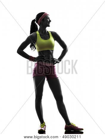 one caucasian woman exercising fitness  standing looking away   in silhouette on white background