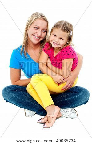 Cute Daughter Sitting In Mother's Lap