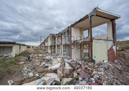 long row of demolished holiday chalets