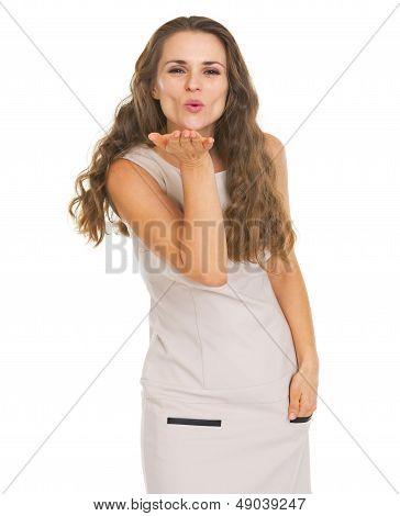 Young Woman Blowing Air Kiss
