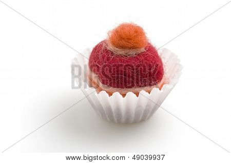 colorful felt praline on a white background