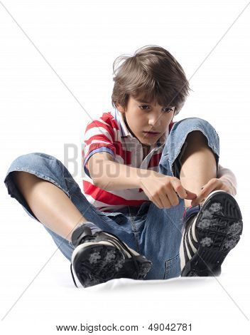 Child Putting On Sneakers