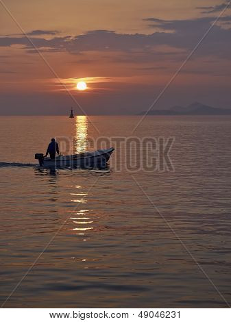 Fisherman At The Sunset