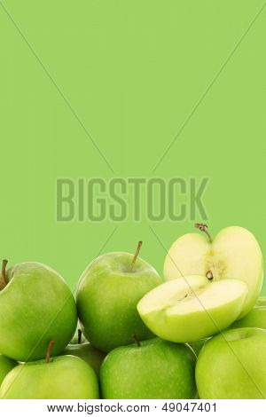 "freshly harvested ""Granny Smith"" apples on a green background with copy space"