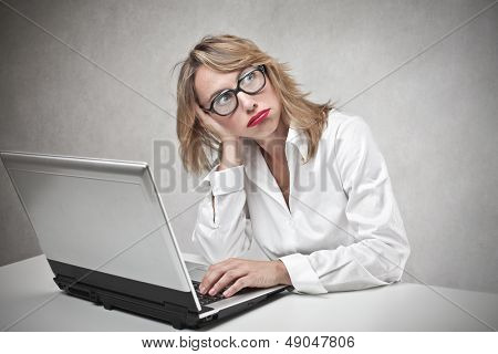 career woman reflects on her desk