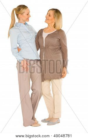 Smiley Grandmother And Young Mother Standing On White Background