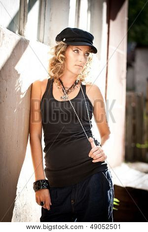 Young caucasian woman with a black gatsby cap