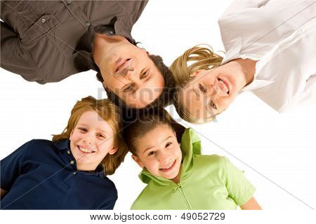 Three Generations Family Laying On Floor Isolated On White Background