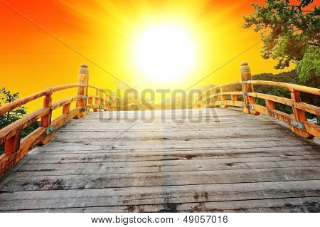Japan is a land of a rising sun. Watching the sunrise from the Japanese bow bridge