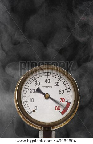 Pressure gauge at maximum omitting smoke in studio