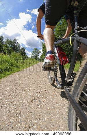 Man on bicycle low section low angle view
